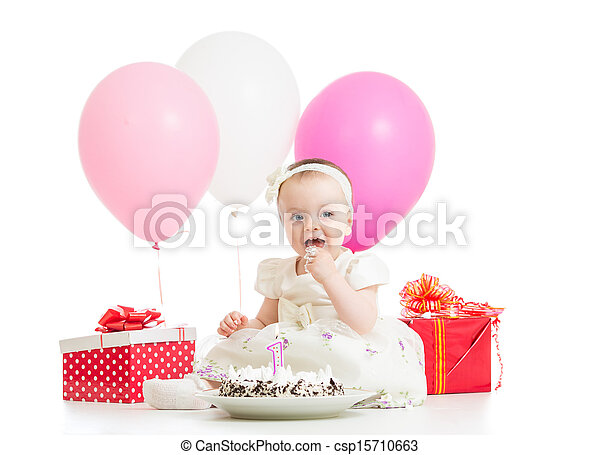 Smiling baby girl eating cake on first birthday - csp15710663