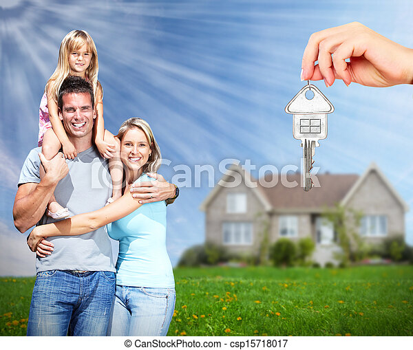 Happy family near new home. - csp15718017