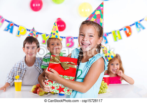 Girl with giftbox at birthday party - csp15728117