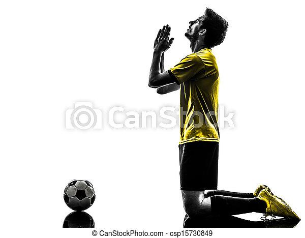 brazilian soccer football player praying  man  - csp15730849