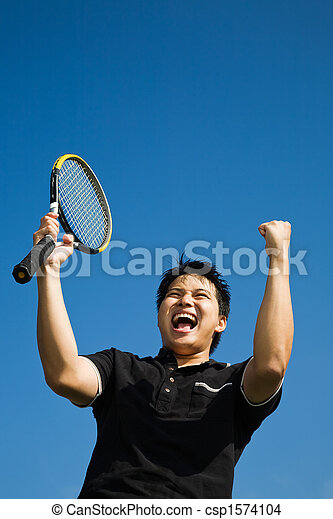Asian tennis player joy of winning - csp1574104