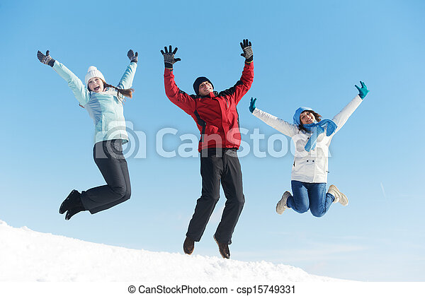 Three jumping young people in winter - csp15749331