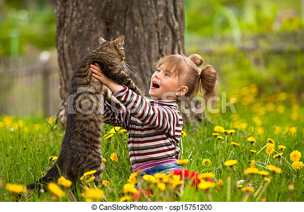 Lovely little girl playing with a cat