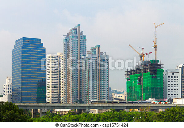 High condominium, Business and constructing building behind the sky train in the metropolis city. - csp15751424