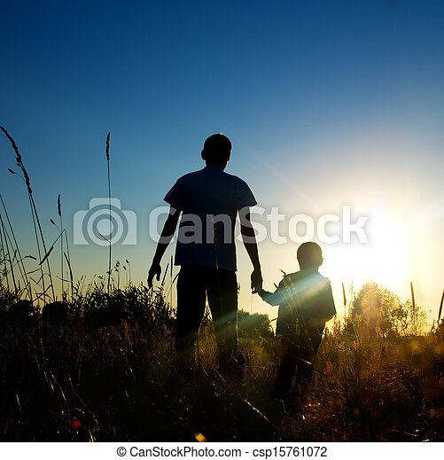 Silhouette father and son at sunset  - csp15761072