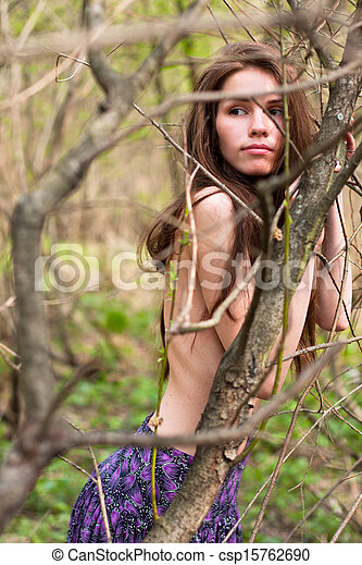 Fashion portrait of young naked woman in the forest - csp15762690