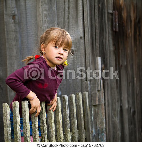 Little five-year girl and vintage rural fence (square) - csp15762763