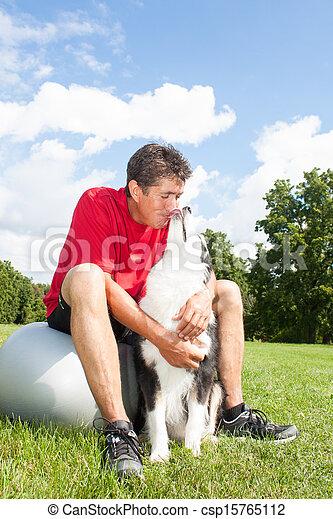 Man hugs his dog