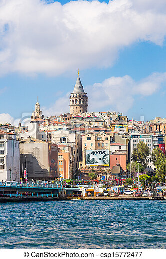 ISTANBUL - MAY 24, 2013: Tourist boat floats past the Galata tower at sunset on may 24, 2013 in Istanbul, Turkey. Golden Horn and the historic Galata area attracts tourists from all over the world. - csp15772477