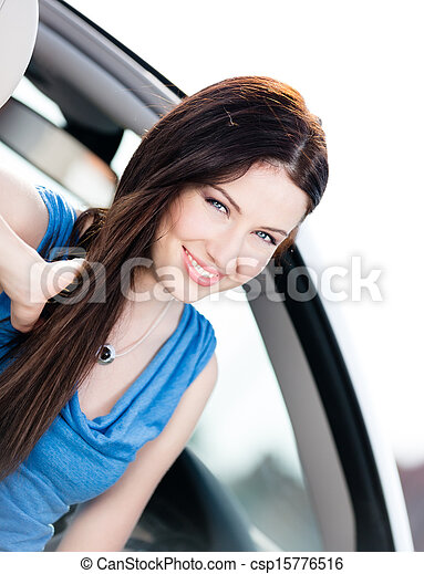 Close up view of woman in the automobile - csp15776516