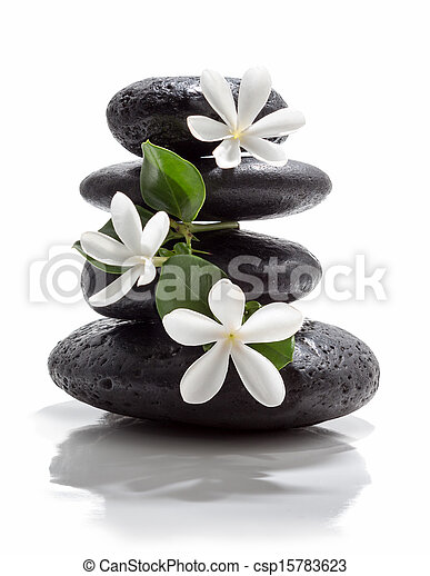 tiare flowers and tower black stone - csp15783623