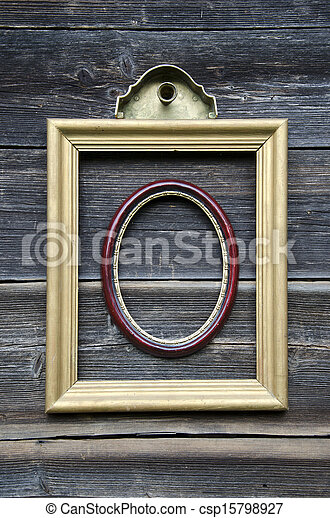 two picture frame on old wooden wall