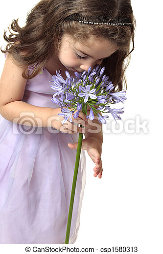 Girl smelling a beutiful flower - csp1580313
