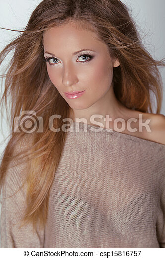 Beautiful Blond Woman. Long brown hair. Fashion model posing at studio. Health care.  Beauty girl with natural make-up. - csp15816757