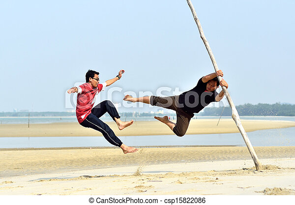 Two friends fighting near the beach - csp15822086