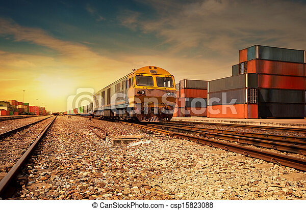 Cargo train platform at sunset with - csp15823088