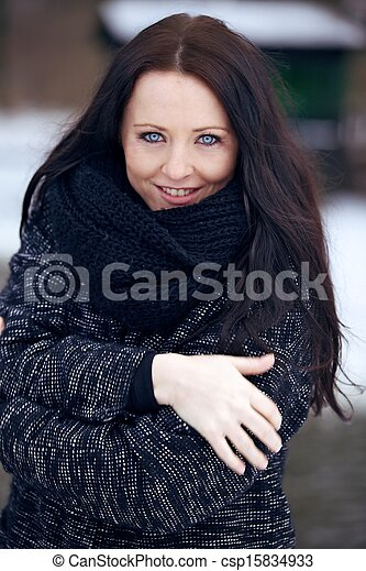Young Brunette Woman in the Freezing Cold Park - csp15834933