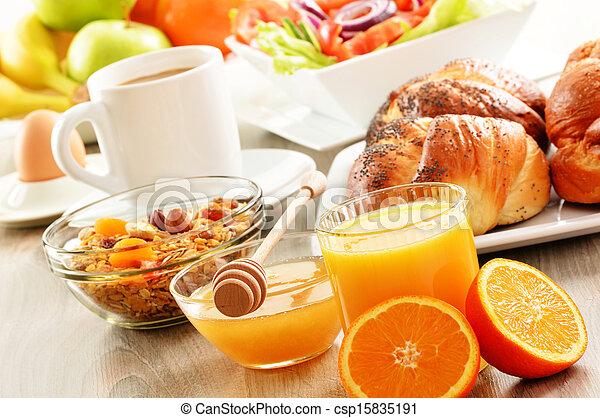 Breakfast including coffee, bread, honey, orange juice, muesli and fruits - csp15835191