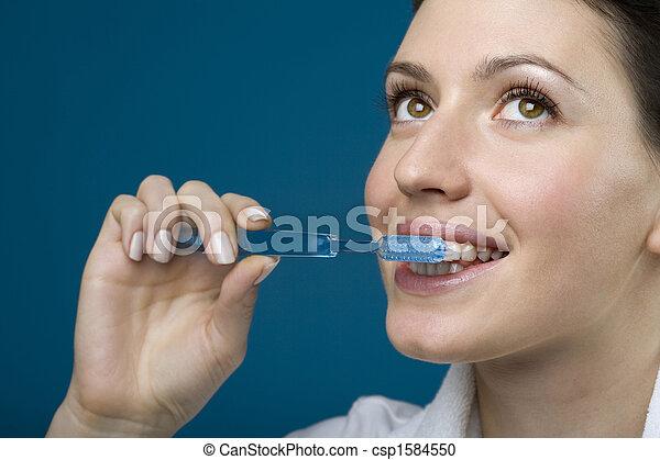 Woman brushing teeth - csp1584550