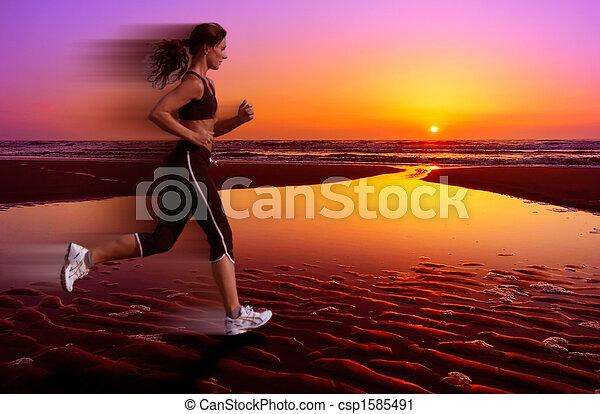 running and sunset - csp1585491