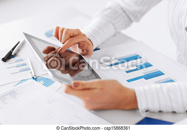 woman with tablet pc and chart papers - csp15868361