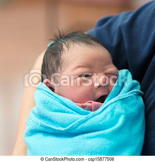 Newborn Asian baby girl and father - csp15877506