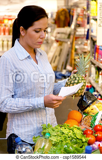 Shopping at the supermarket with a shopping list - csp1589544