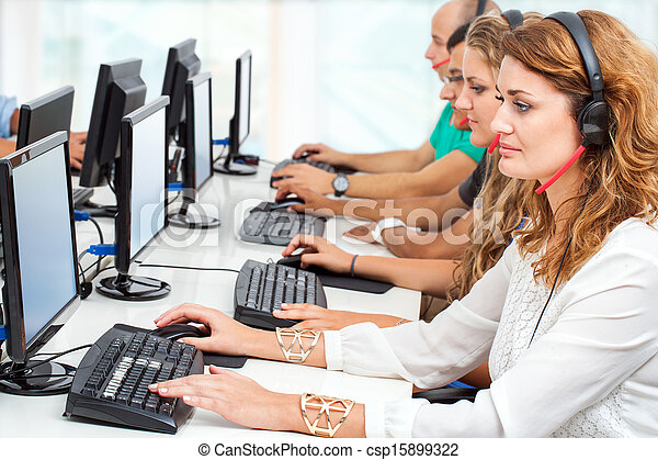 Stock Photo of Young business people working on computers ...