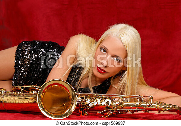 Young woman with her Saxophones - csp1589937