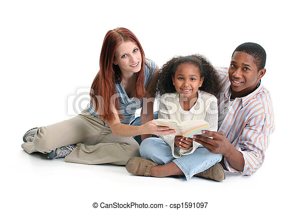Interracial Family Reading Together - csp1591097