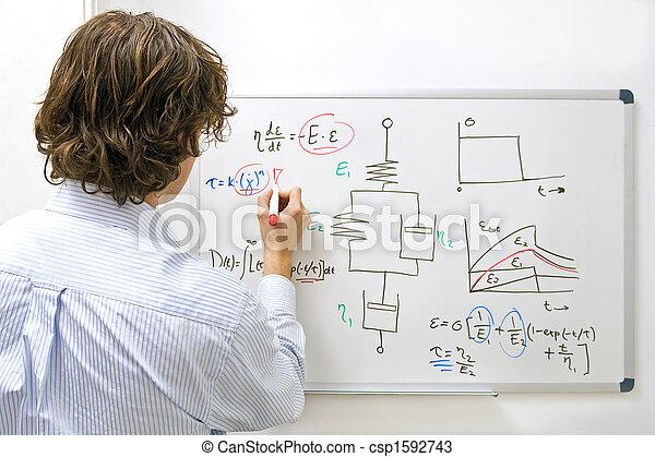 Engineer at whiteboard - csp1592743