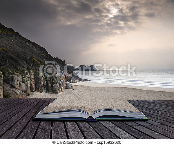 Creative concept pages of book Porthcurno yellow sand beach before sunset Cornwall England - csp15932620