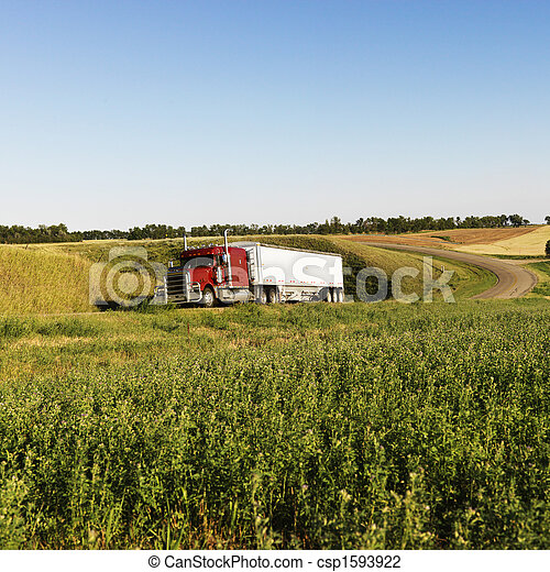 Semi truck on rural road. - csp1593922