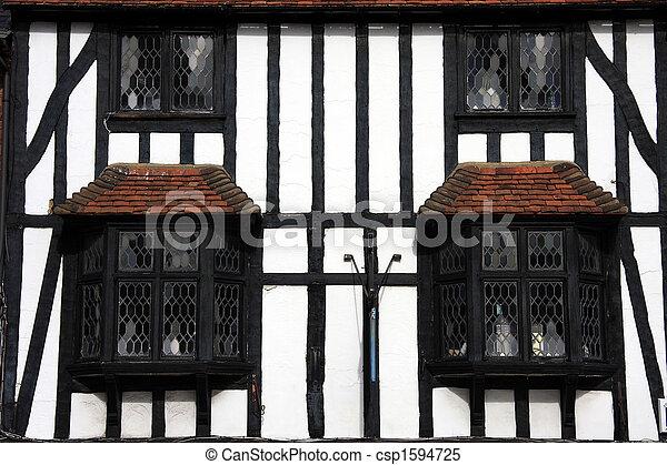 Tudor Beamed Building In Close Crop - csp1594725
