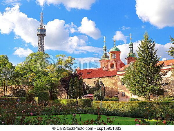Petrin Lookout Tower (Petrinska rozhledna) in park in center of Prague under blue sky in summer. Czech - csp15951883
