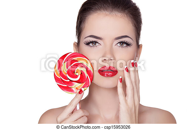 Fashion make up. Beauty Girl Portrait holding Colorful lollipop. Hot red lips. Nail polish manicured nails. Skin care. Isolated on white background - csp15953026