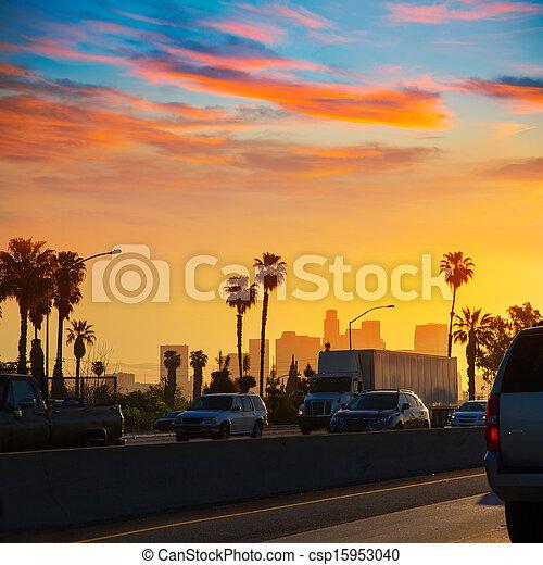 LA Los Angeles sunset skyline with traffic California - csp15953040
