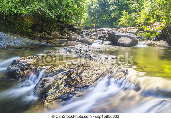 Deep forest waterfall at Kenyir lake, Malaysia - csp15956803