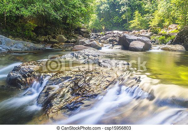 Deep forest waterfall at Kenyir lake, Malaysia - csp15956803