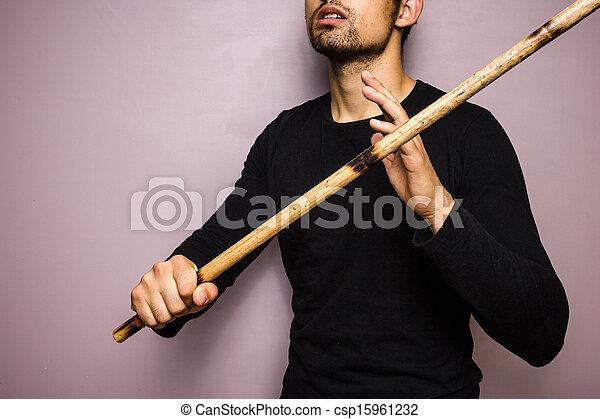Eskrima stick-fighter with rattan stick