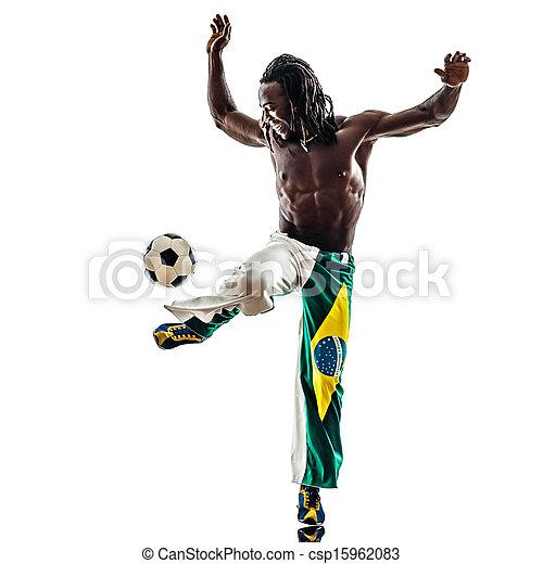 brazilian  black man soccer player juggling football - csp15962083