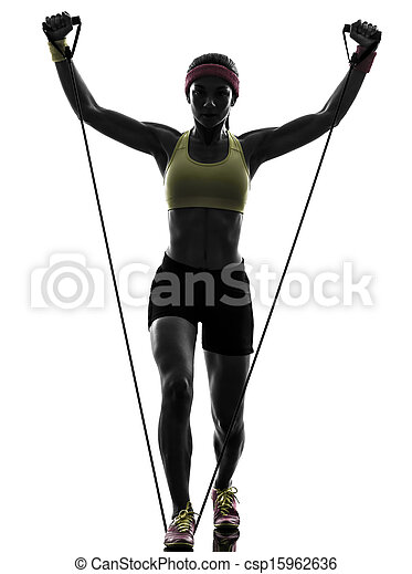 one woman exercising fitness workout resistance bands in silhouette on ...