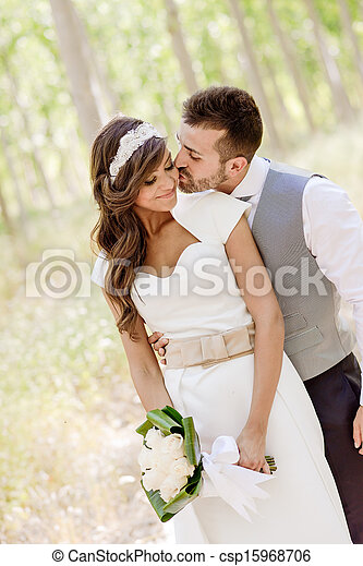 Just married couple in nature background - csp15968706