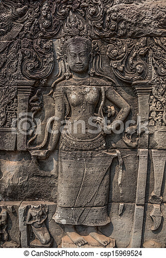 Apsara carved on the wall of the Elephant terrace, Angkor Thom. cambodia. Asia, Tradition, Culture and Religion. - csp15969524