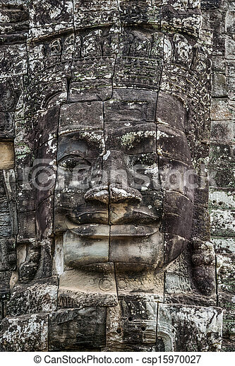 Stone head on towers of Bayon temple in Angkor Thom, Cambodia. South East Asia. Tradition, Culture and Religion. - csp15970027