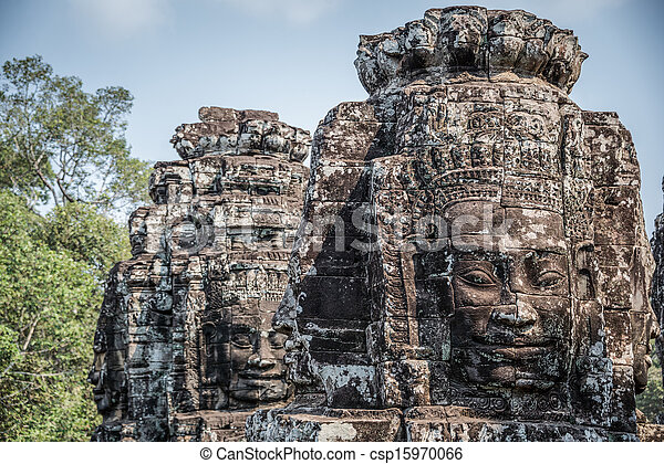 Stone head on towers of Bayon temple in Angkor Thom, Cambodia. South East Asia. Tradition, Culture and Religion. - csp15970066
