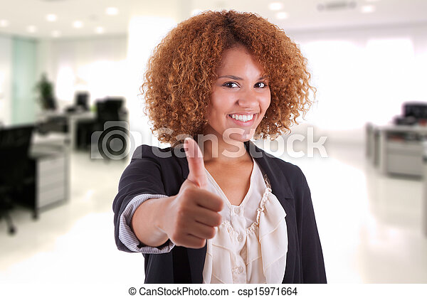 Portrait of a young african american business woman thumbs up, isolated on white background - Black people - csp15971664