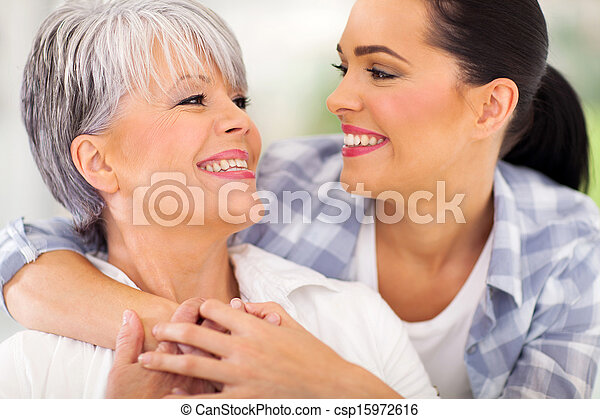 middle aged mother and young adult daughter - csp15972616