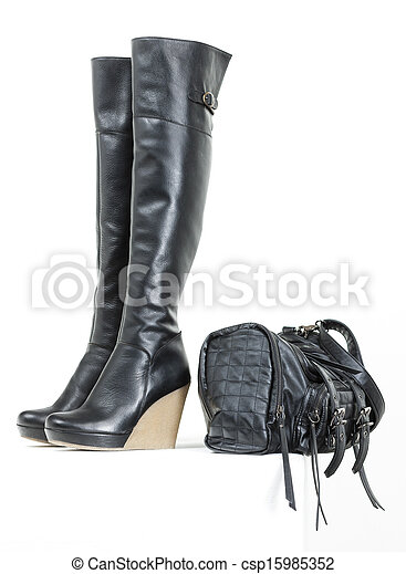 fashionable platform black boots with a handbag - csp15985352