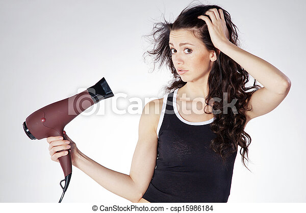 woman blow dry hair